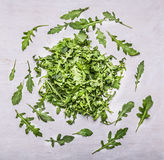 Herb arugula nested circles on a white wooden background top view Stock Image
