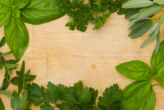 Herb border on wooden background Stock Photos