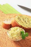 Herb butter. Bowl of herb butter and slices of bread stock images