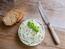 Herb butter in a bowl on wood Stock Images