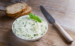 Herb butter in a bowl on wood Stock Image