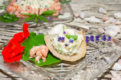 Herb butter and prawns with nasturtium Stock Photo