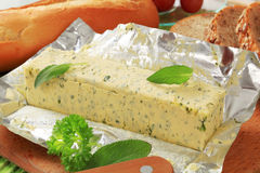 Herb butter. Stick of fresh herb butter and bread stock image