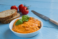 Herb butter tomato in a bowl on wood Royalty Free Stock Photography