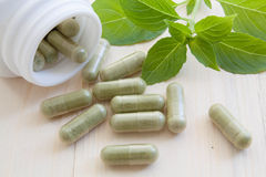 Herb capsules Royalty Free Stock Photography