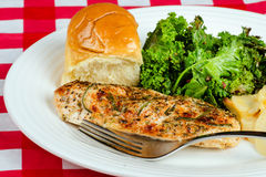 Herb-crusted baked chicken breast Stock Photography