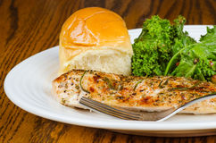 Herb-crusted baked chicken breast Royalty Free Stock Image