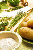 Freh herbs. Herb dip, potatoes and fresh herbs on wooden cutting board Stock Photography