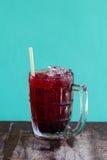 Herb drink Roselle juice on grunge wood floor Stock Photos
