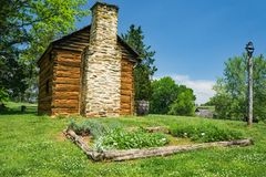 Herb Garden at the Booker T Washington Monument. Hardy, VA – May 6th; View of an herb garden next to a log cabin at the Booker T Washington Monument stock photography