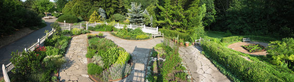 Herb Garden. A panoramic photo of a formal herb garden with a stone pathway royalty free stock images