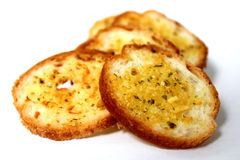 Herb and garlic crusty bread ready to serve. Stock Photo