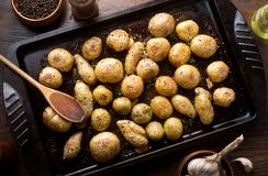 Herb and garlic roasted baby potatoes. Delicious homemade herb and garlic roasted baby potatoes stock photos