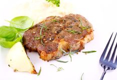 Herb Grilled steak meat with onion, basil and potato Royalty Free Stock Photo