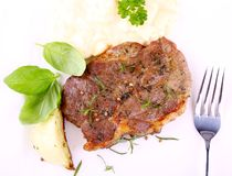 Herb Grilled steak meat with onion, basil and potato salad Stock Images