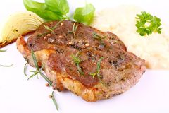 Herb Grilled steak meat with onion, potato salad Stock Photography
