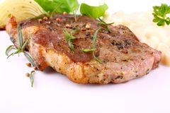 Herb Grilled steak meat with potato salad, onion and basil Stock Images