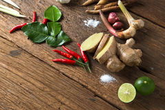Herb ingredient of Tom Yum spicy soup  Traditional Thai food cuisine on wood background Royalty Free Stock Photo