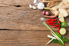 Herb ingredient of Tom Yum spicy soup Traditional Thai food cuisine on wood texture background. Local ingredient soup tom yam on wooden background stock photos