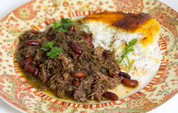 Herb lamb koresh meal. Iranian (Persian) herb and lamb koresh served with Persian saffron rice. The meat is slowly stewed with masses of parsley, coriande and royalty free stock photos