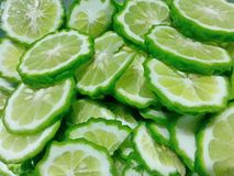 Herb lime pictures Painted. Painted lime pictures herb sliced Sliced green background diet Stock Photos