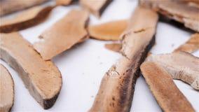 Herb medicine HuaJuHong or Citri Grandis Exocarpium or Tomentose Pummelo Peel rotate and pause. Side view herb medicine HuaJuHong or Citri Grandis Exocarpium or stock video footage