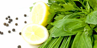 Herb-Mix. Mix of chives, basil and parsley decorated with lemon halves and pepper Stock Photography
