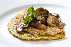 Herb and Mushroom Omelette. Garnished with basil. Delicious royalty free stock photo