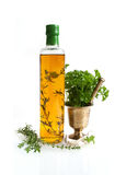 Herb oil and a brass mortar Stock Photography