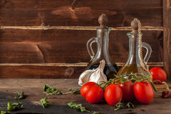 Herb, oil, garlic and tomatoes Stock Image