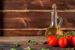 Herb, oil and tomatoes Royalty Free Stock Photo