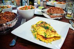 Herb omelette on the breakfast Royalty Free Stock Images