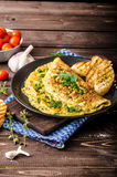 Herb omelette with chives and oregano sprinkled with Herb omelette with chili flakes Stock Photography
