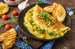 Herb omelette with chives and oregano sprinkled with Herb omelette with chili flakes Royalty Free Stock Image