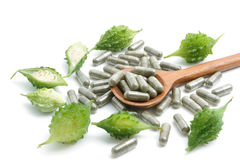 Herb pills with bitter gourd ,homeopathic medicine on white back Stock Photos