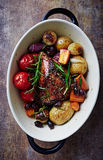 Herb roast pork with roast vegetables Royalty Free Stock Images