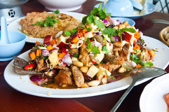 Herb salad with deep fried fish Stock Photos
