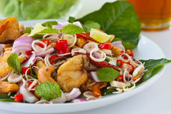 Herb salad with deep fried fish and shrimp (Thai f. Thai fusion and healthy food, Herb salad with deep fried Fish and shrimp dreesing with sweet sauce Stock Photos