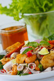 Herb salad with deep fried fish and shrimp (Thai f. Thai fusion and healthy food, Herb salad with deep fried Fish and shrimp dreesing with sweet sauce Royalty Free Stock Photos