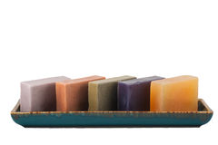 Herb soaps. A group of herb soaps on a white background Royalty Free Stock Image