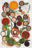 Herb and Spice Abstract. With chilli olive oil and measuring spoons over distressed white wood background royalty free stock photography