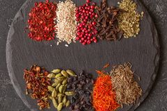 Herb and spice ingredients on slate. Food background Stock Photography