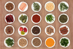 Herb and Spice Sampler. Large herb and spice sampler over papyrus background Stock Image