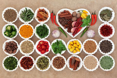 Herb and Spice Sampler. Large herb and spice selection in a heart and porcelain crinkle bowls Stock Photography