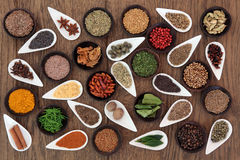 Herb and Spice Sampler. Large herb and spice sampler in a selection of wooden and porcelain bowls stock images