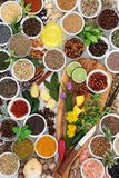 Herb and Spice Seasoning. With fresh and dried herbs, spices and edible flowers on olive wood board and rustic background Top view stock image