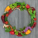Herb and Spice Wreath. With a selection of dried and fresh herbs and flowers on rustic wood background stock photo