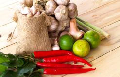 Herb and Spicy indredients for making Thai food on the wooden. Many Herb and Spicy indredients for making Thai food on the wooden Royalty Free Stock Photography