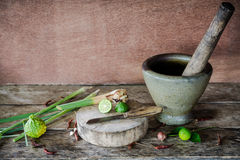 Herb and spicy ingredients of thai food on wooden background in Stock Photos