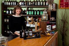Herb store proprietor smiling Stock Photo